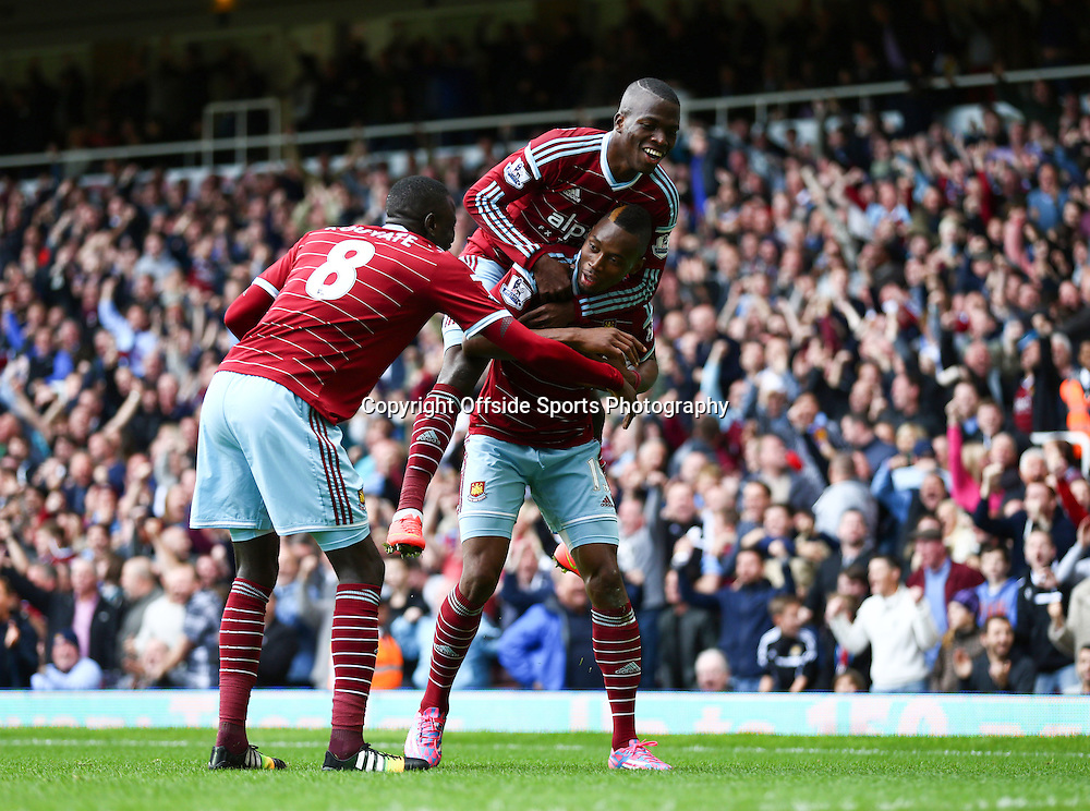 25 October 2014 - Barclays Premier League - West Ham v Manchester City - Diafra Sakho of West Ham celebrates scoring the winning goal with team mates - Photo: Marc Atkins / Offside.