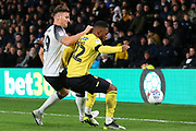Millwall defender Mahlon Romeo (12) is challenged by Derby County forward Chris Martin (19) during the EFL Sky Bet Championship match between Derby County and Millwall at the Pride Park, Derby, England on 14 December 2019.
