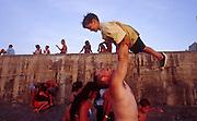 25 JULY 2002 - HAVANA, HAVANA, CUBA: A man plays with his son on the Malecon in Havana, Cuba, July 25, 2002..PHOTO BY JACK KURTZ