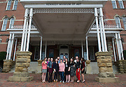 A portion of the students involved in the Museum Studies Certificate program pose for a photograph outside of the Kennedy Museum of Art on the day of their reception. This was the first program exhibition. Photo by Olivia Wallace