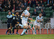 Racing 92 player THIBAULT DUBARRY (C) makes a clear sprint during the Natixis Cup rugby match between French team Racing 92 and New Zealand team Otago Highlanders at Sui San Wan Stadium in Hong Kong. MARC ANDREU (R) comes in to take a pass.