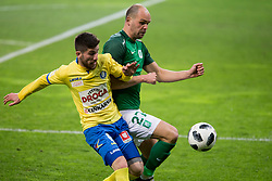 Nino Pungarsek of NK Celje and Aris Zarifovic of NK Olimpija Ljubljana during football match between NK Olimpija Ljubljana and NK Celje in 1st leg match in Semifinal of Slovenian cup 2017/2018, on April 4, 2018 in SRC Stozice, Ljubljana, Slovenia. Photo by Urban Urbanc / Sportida