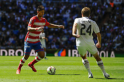 05.04.2015, Estadio Santiago Bernabeu, Madrid, ESP, Primera Division, Real Madrid vs FC Granada, 29. Runde, im Bild Real Madrid&acute;s Asier Illarramendi and Granada&acute;s Eddy Pascual // during the Spanish Primera Division 29th round match between Real Madrid CF and Granada FC at the Estadio Santiago Bernabeu in Madrid, Spain on 2015/04/05. EXPA Pictures &copy; 2015, PhotoCredit: EXPA/ Alterphotos/ Luis Fernandez<br /> <br /> *****ATTENTION - OUT of ESP, SUI*****