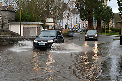 © Licensed to London News Pictures. 29/01/2020. Builth Wells, Powys, Wales, UK. Vehicles negotiate the flooded A483 route through Builth Wells. The river Wye bursts it's banks at Builth Wells in Powys as rain continues to fall in Wales. Photo credit: Graham M. Lawrence/LNP