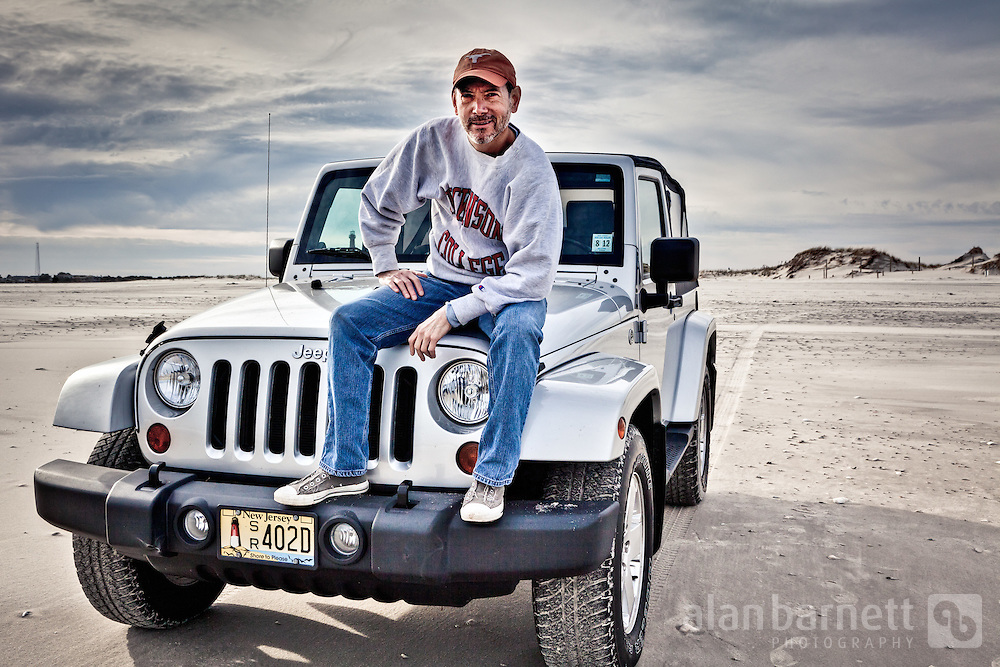 portrait of a man sitting on the hood of a jeep wrangler. Black Bedroom Furniture Sets. Home Design Ideas