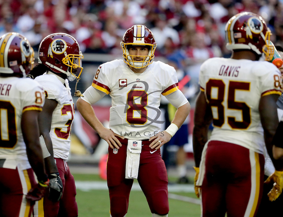 Washington Redskins quarterback Kirk Cousins (8) huddles up his teammates during the first half of an NFL football game against the Arizona Cardinals, Sunday, Dec. 4, 2016, in Glendale, Ariz. (AP Photo/Rick Scuteri)