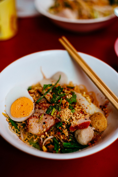 Noodles with pork at a small street stall near Chinatown in Bangkok, Thailand.