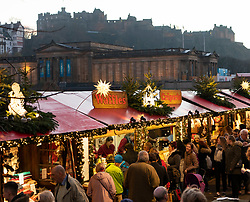 Edinburgh, Scotland, UK. 18 November, 2018. The annual Edinburgh Christmas market opened this weekend and thousands of locals and tourists enjoyed the traditional entertainment, food and drinks on offer as dusk descended on the city.