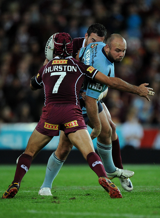 July 6th 2011: Glenn Stewart of the Blues is attempts to off load the ball in the tackle during game 3 of the 2011 State of Origin series at Suncorp Stadium in Brisbane, QLD, Australia on July 6, 2011. Photo by Matt Roberts / mattrimages.com.au / QRL