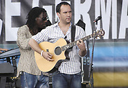 "PHILADELPHIA - JULY 02:  Singer Dave Matthews (R) and violinist Boyd Tinsley perform on stage at ""Live 8 Philadelphia"" at the Philadelphia Museum of Art July 2, 2005 in Philadelphia, Pennsylvania. The free concert is one of ten simultaneous international gigs including London, Berlin, Rome, Paris, Barrie, Tokyo, Cornwall, Moscow and Johannesburg. The concerts precede the G8 summit (July 6-8) to raising awareness for MAKEpovertyHISTORY.  (Photo by William Thomas Cain/Getty Images)"