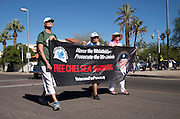 Participants in Veterans for Peace carry a banner addressing Chelsea Manning and march in the Veterans Day Parade, which honors American military veterans, in Tucson, Arizona, USA.