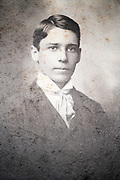 vintage deteriorating head and shoulder portrait of a young adult boy