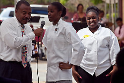 Mr. Leayle Robinson, Dean of Students, has culinary education students Jamisha Belange and Makisha Todman talk about what dishes the department has prepared for the event.  Culinary students will make use of fish and vegetables from the tilapia and hydroponic farm.