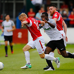 AUGUST 12:  Dover Athletic against Wrexham in Conference Premier at Crabble Stadium in Dover, England. Wrexham's midfielder Marcus Kelly keeps Dover's defender Femi Ilesanmi from the ball. (Photo by Matt Bristow/mattbristow.net)