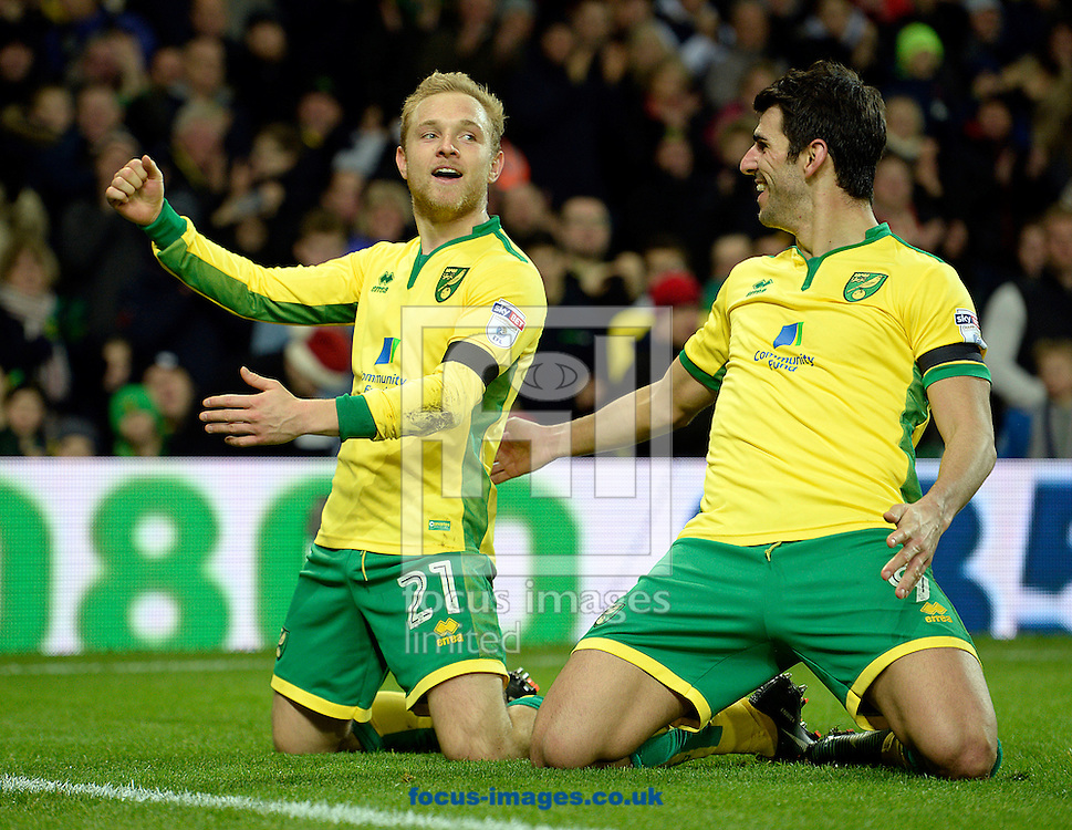 Alex Pritchard of Norwich City celebrates with Nelson Oliveira, scoring the fifth goal against Brentford during the Sky Bet Championship match at Carrow Road, Norwich<br /> Picture by Matthew Usher/Focus Images Ltd +44 7902 242054<br /> 03/12/2016