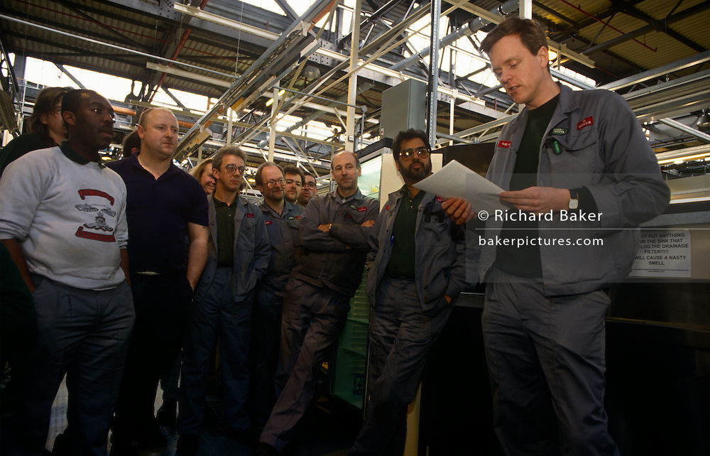 Car workers gather to hear from a union representative during a union meeting during the scheduled rest break in the German BMW-owned Rover production factory in Cowley, Solihull, England. Employees listen to news and  employment terms and conditions. Motor car production has taken place at Cowley near the city of Oxford, England for over ninety years. The car factory is known today as Plant Oxford and is now owned by BMW and has been extensively redeveloped. It remains the largest industrial employer in Oxfordshire employing more than 4,300 people.