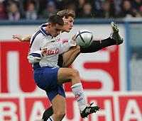 Fotball. 23. oktober 2004, <br /> Bundesliga Hansa Rostock - FC Bayern München<br /> v.l. David Rasmussen Rostock, Bastian Schweinsteiger