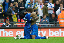 LONDON, ENGLAND - Saturday, May 17, 2008: Portsmouth's  Sylvain Distin (R) embraces a team-mate as they celebrate winning the cup after beating Cardiff City 1-0 during the FA Cup Final at Wembley Stadium. (Photo by Chris Ratcliffe/Propaganda)