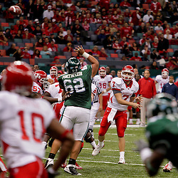 Oct 17, 2009; New Orleans, LA, USA; Houston Cougars quarterback Case Keenum (7) throws a ball to wide receiver L.J. Castile (10) during a game against the Tulane Green Wave at the Louisiana Superdome. Houston defeated Tulane 44-16.   Mandatory Credit: Derick E. Hingle-US PRESSWIRE