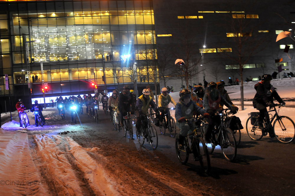 As part of Montreal's 375th anniversary, Velo Quebec hosted Lune D'Hiver a Velo or night winter cycling. Bundled up cyclists rode through parts of downtown to the Old Port in promotion and celebration of year round cycling in Montreal. February 2017. (Cult MTL)