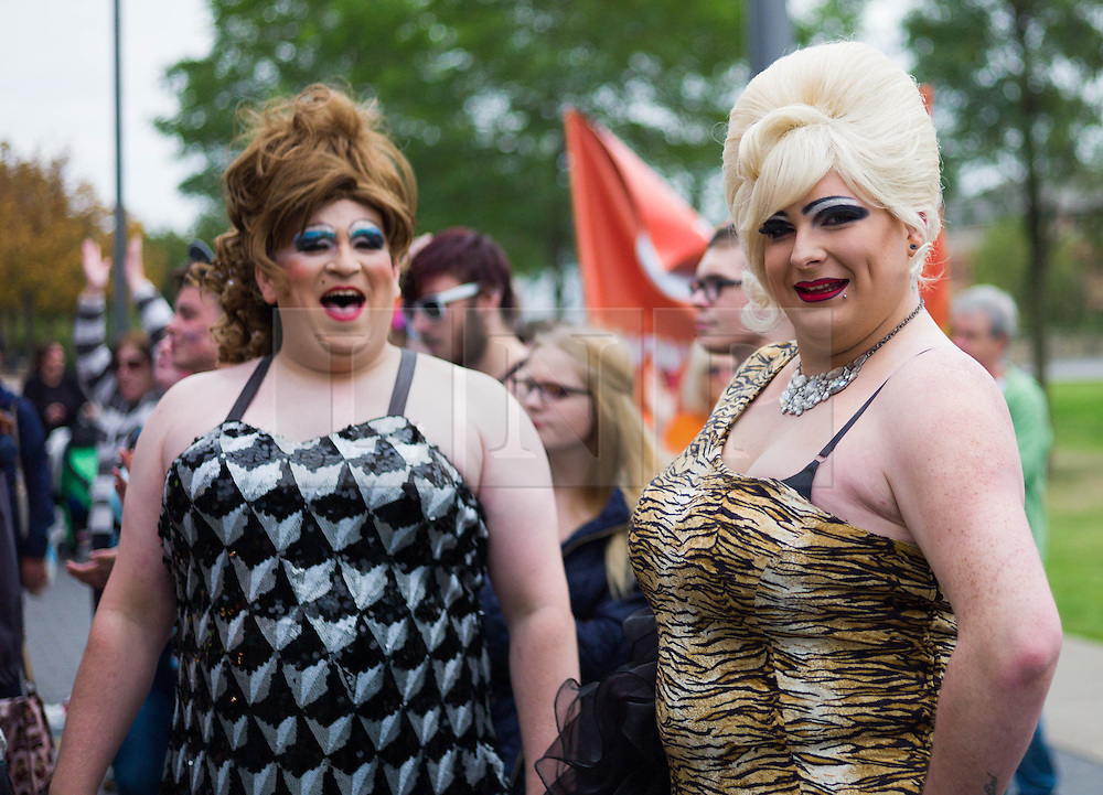 © Licensed to London News Pictures. <br /> 27/09/2014. <br /> <br /> Middlesbrough, United Kingdom<br /> <br /> Drag queens enjoy the entertainment during the Middlesbrough Pride event. The event brings together many members of the Lesbian, Gay, Bisexual and Transgender community from the area.<br /> <br /> Photo credit : Ian Forsyth/LNP