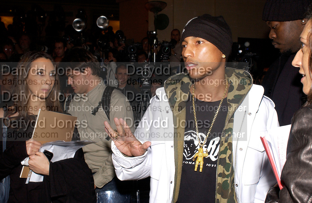 Pharrell Williams, Versace Haute couture fashion show at the Ritz,  and after party.  19 January 2004. © Copyright Photograph by Dafydd Jones 66 Stockwell Park Rd. London SW9 0DA Tel 020 7733 0108 www.dafjones.com