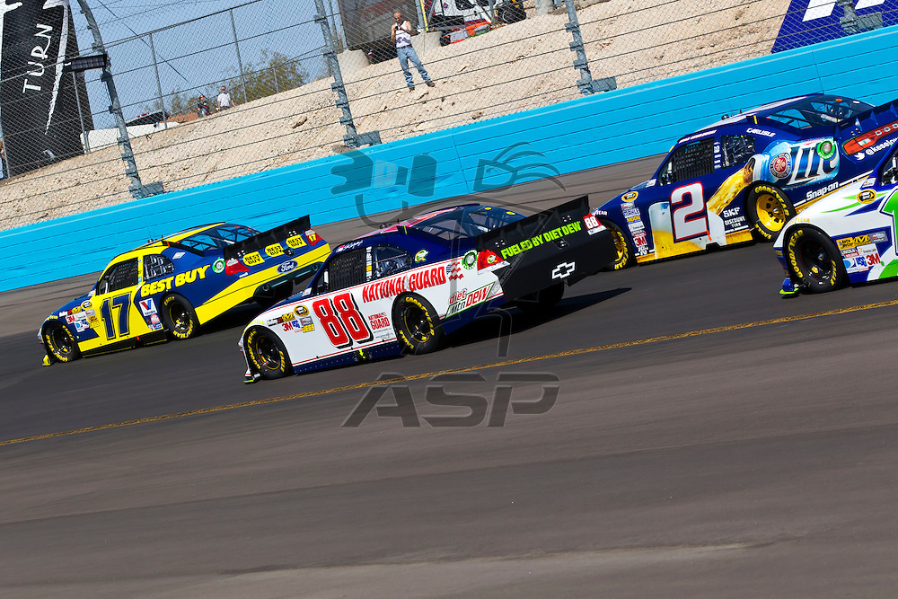 AVONDALE, AZ - MAR 04, 2012:  The NASCAR Sprint Cup teams take to the track for the running of the Subway Fresh Fit 500 race at the Phoenix International Raceway in Avondale, AZ.