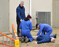 Students participate in a first aid scenario with theatrical explosions and simulated gunfire as part of the Hostile Environments First Aid Training course on Monday, March 25th, 2015 in Hellertown, Pa. Photo By | CHRIS POST