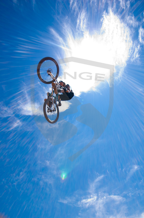 mountain bike wonder kid rory eastman jumps into the stratosphere while session-ing at the santa fe dirt jumps in santa fe, new mexico.