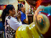 12 JULY 2018 - SAMUT PRAKAN, SAMUT PRAKAN, THAILAND: People pray and make merit in the Lak Mueang Shrine, about two blocks from the Talat Pak Nam, the main market in Samut Prakan, about 20 miles from central Bangkok.         PHOTO BY JACK KURTZ