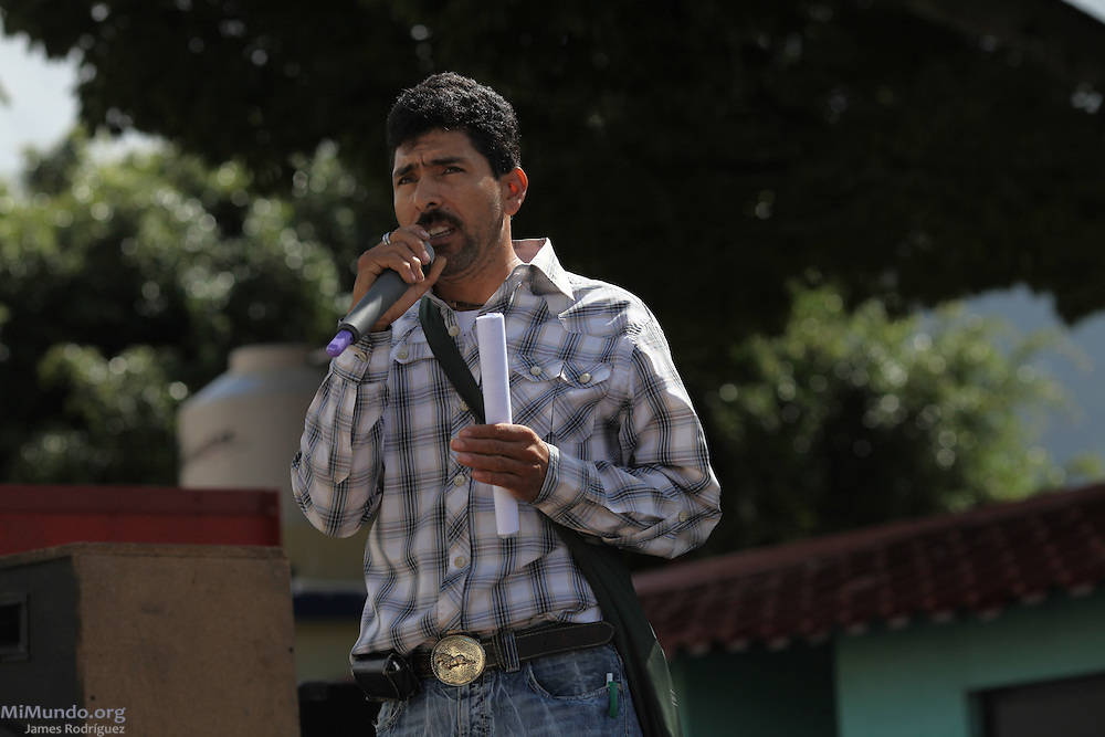 Roberto Pivaral, from the Committee to Hold the Consultation of Mining, speaks as hundreds gather in the main square of San Rafael Las Flores, Guatemala, to demand that a community plebiscite  on industrial mining be carried out in the municipality. The San Rafael Mine, 60% owned by US-based Tahoe Resources and 40% by Canadian mining giant Goldcorp, has been operating since 2011 without having previously consulted the local residents - a violation to numerous international conventions. San Rafael Las Flores, Santa Rosa, Guatemala. July 20, 2012.
