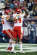 Kansas City Chiefs tight end Demetrius Harris (84) celebrates with Kansas City Chiefs offensive guard Laurent Duvernay-Tardif (76) after catching a 7 yard first quarter touchdown pass that ties the score at 7-7 during the 2017 NFL week 1 regular season football game against the New England Patriots, Thursday, Sept. 7, 2017 in Foxborough, Mass. The Chiefs won the game 42-27. (©Paul Anthony Spinelli)