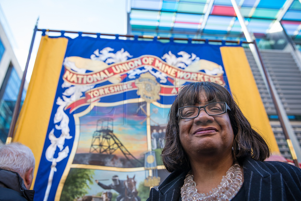 © Licensed to London News Pictures. 13/03/2017. London, UK. Diane Abbot MP, Shadow Secretary of State for Health, stands for a photograph with protestors outside the Home Office. Campaigners are calling for an inquiry into the police handling of clashes with strikers during the miners' strike at Orgreave in the 1980s. Photo credit: Rob Pinney/LNP