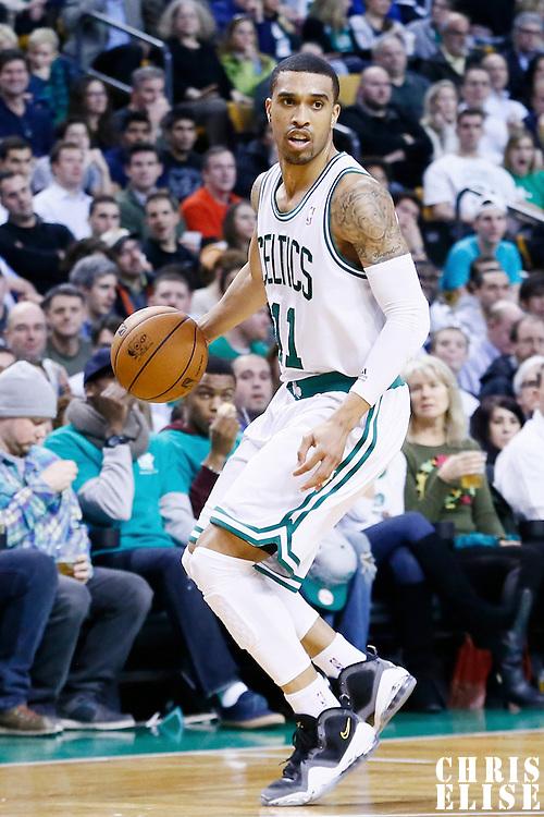 30 January 2013: Boston Celtics shooting guard Courtney Lee (11) looks to pass the ball during the Boston Celtics 99-81 victory over the Sacramento Kings at the TD Garden, Boston, Massachusetts, USA.
