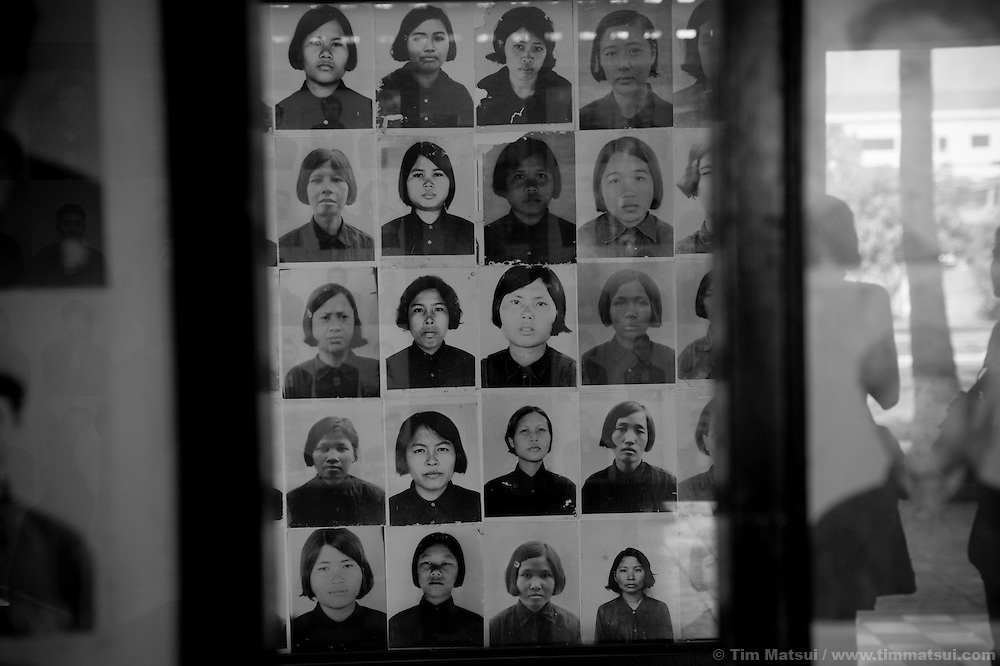 Displays of restraints, torture implements, and photographs of victims taken by their captors, the Khmer Rouge, at S-21 now known as the Toul Sleng Genocide Museum in Phnom Penh, Cambodia. Once a school, S-21 was converted into a prison by the Khmer Rouge for the interrogation, torture and killing of anyone suspected of being a threat to the regime. Many victims, after their forced confessions, were taken to the nearby Killing Field of Choeung Ek where later 129 mass graves were found of which 86 were excavated. Upwards of 20,000 People were killed by bludgeon, knife, and poison at Choeung Ek, at times at a rate of 300 per day. An estimated 3 million people lost their lives, killed or starved, during the reign of the Khmer Rouge from 1975-1979.