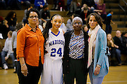 February 01, 2014.  MCHS Varsity Girls Basketball vs Manassas Park.  Madison wins 42-23.  Madison Coach Katherine Johnson honored for her 36 years of coaching at MCHS.  Prior to Saturday night's game, Katherine Johnson poses with three generations of former players.  Cheryl Williams Greene (left) played on Coach Johnson's first team in 1978.  Cheryl's daughter, Tangi Greene (right) played for Coach Johnson from 1992-1995, and Tangi's daughter, Sierra Smith is a freshman playing on Johnson's current, and last, team.