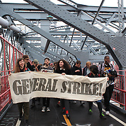 Protesters during the Occupy Brooklyn March over the Williamsburg Bridge, New York, USA. 1st May 2012. Photo Tim Clayton