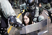 HONG KONG: 06 October 2019 A young female demonstrator is arrested by police during clashes in the Causeway Bay area of Hong Kong earlier today. Hundreds of thousands of protesters marched through the city's streets in defiance of the new 'no-mask' law, which was introduced two days ago as demonstrations roll into a 14th week. <br /> Rick Findler / Story Picture Agency