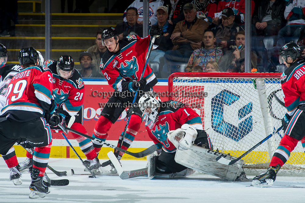 KELOWNA, CANADA - OCTOBER 28:  Kyle Topping #24 and Braydyn Chizen #22 clear the puck from in front of the net of James Porter #1 of the Kelowna Rockets during first period against the Prince George Cougars on October 28, 2017 at Prospera Place in Kelowna, British Columbia, Canada.  (Photo by Marissa Baecker/Shoot the Breeze)  *** Local Caption ***