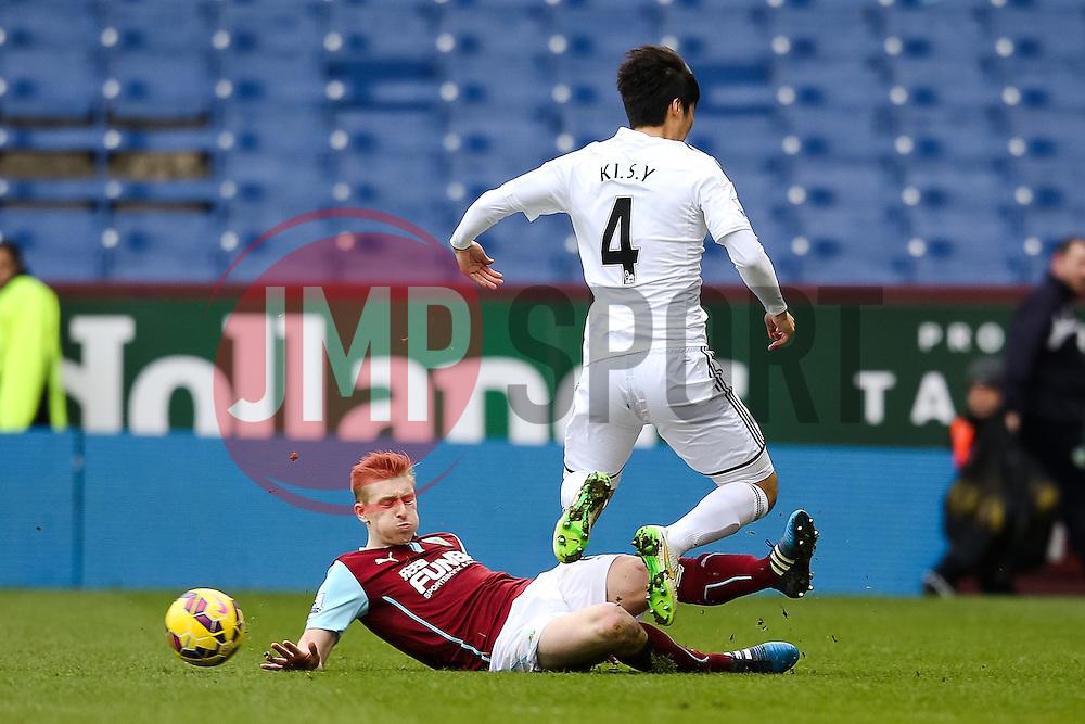Burnley's Simon Mee tackles Ki Sung-Yeung of Swansea City   - Photo mandatory by-line: Matt McNulty/JMP - Mobile: 07966 386802 - 28/02/2015 - SPORT - Football - Burnley - Turf Moor - Burnley v Swansea City - Barclays Premier League