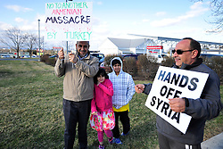 """4/6/2014 Allentown, PA. Nazih """"Nick"""" Zarif Mouhrez of Catasauqua (right)stands with other protestors. PA Members of the Lehigh Valley Syrian community gather at the corner of Airport Road and Union Boulevard in Allentown to protest against supporting terrorist groups in Syria. Photo 