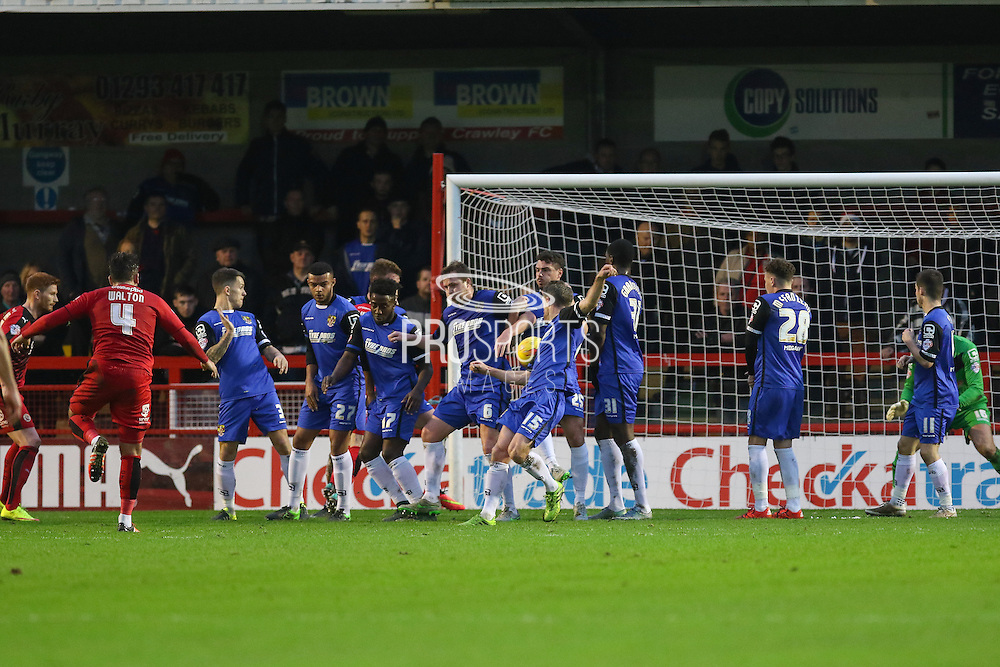 Simon Walton of Crawley Town shoots with a free kick during the Sky Bet League 2 match between Crawley Town and Stevenage at the Checkatrade.com Stadium, Crawley, England on 26 December 2015. Photo by Phil Duncan.