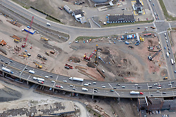 """Early Eastbound Approach Construction, Pearl Harbor Memorial """"Q"""" Bridge, just east of Interstate I-95 I-91 CT Route 34 Interchanges. Surface roads Water Street left to right & East Street on right. Details of approaches, overpasses, ramps & roadway near or within I-95 New Haven Harbor Crossing Corridor projects confines. Photography taken at the beginning of Contract B1 & E1"""