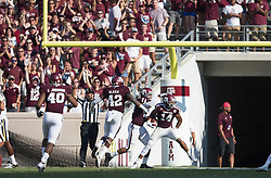 Texas A&M defensive back Justin Evans (14) reacts after intercepting a pass from UCLA quarterback Josh Rosen (3) during the fourth quarter of an NCAA college football game Saturday, Sept. 3, 2016, in College Station, Texas. Texas A&M won 31-24. (AP Photo/Sam Craft)