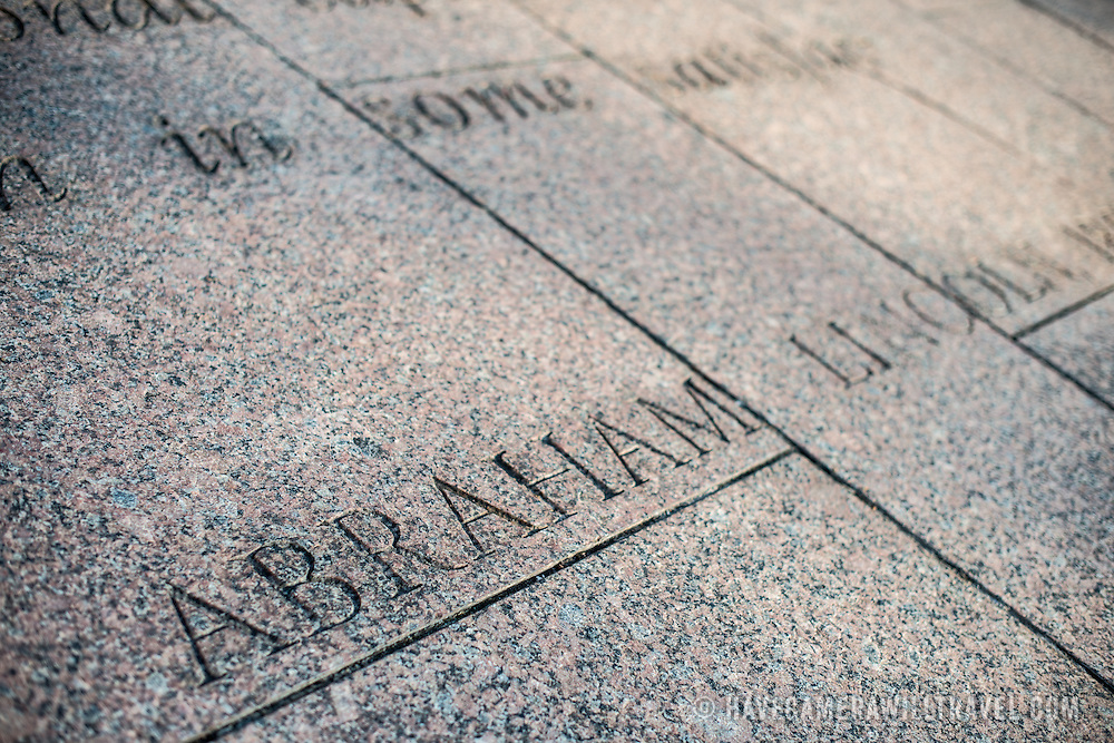 The inscription of Abraham Lincoln's name beneath a quote by the former president carved into the granite paving at Freedom Plaza on Pennsylvania Avenue in downtown Washington DC.