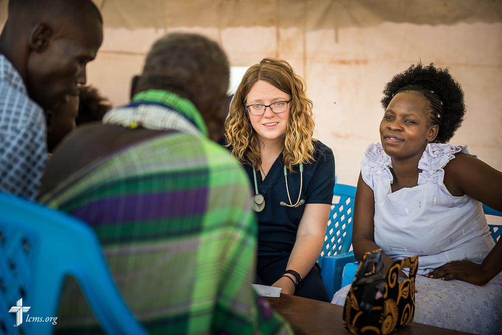 Sarah Kanoy, a career missionary in East Africa takes the time to talk with a patient at the LCMS Mercy Medical Team on Monday, June 20, 2016, in Nataparkakono, a village in Turkana, Kenya.  LCMS Communications/Erik M. Lunsford