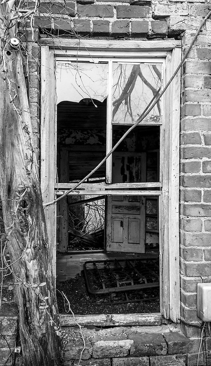 Broken window from a scary old abandoned house on Union Cross Rd. near Walburg, North Carolina