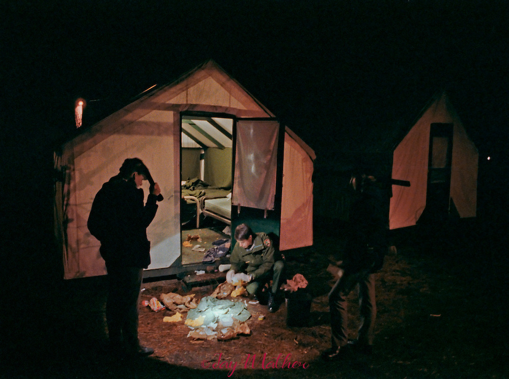 Yosemite Park Ranger Kim Aufhauser checks for illegal drugs in a Curry Company employee tent.  Despite what many believe, Yosemite is strictly governed by Federal laws.  December 1988