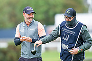Paul Waring and his caddy share a joke as they leave the forst green during the final round of the Alfred Dunhill Links Championship European Tour at St Andrews, West Sands, Scotland on 29 September 2019.