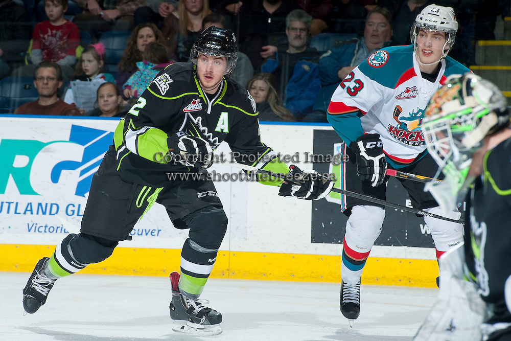 KELOWNA, CANADA -FEBRUARY 7: Cody Corbett #2 of the Edmonton Oil Kings checks Justin Kirkland #23 of the Kelowna Rockets during first period on February 7, 2014 at Prospera Place in Kelowna, British Columbia, Canada.   (Photo by Marissa Baecker/Getty Images)  *** Local Caption *** Cody Corbett; Justin Kirkland;
